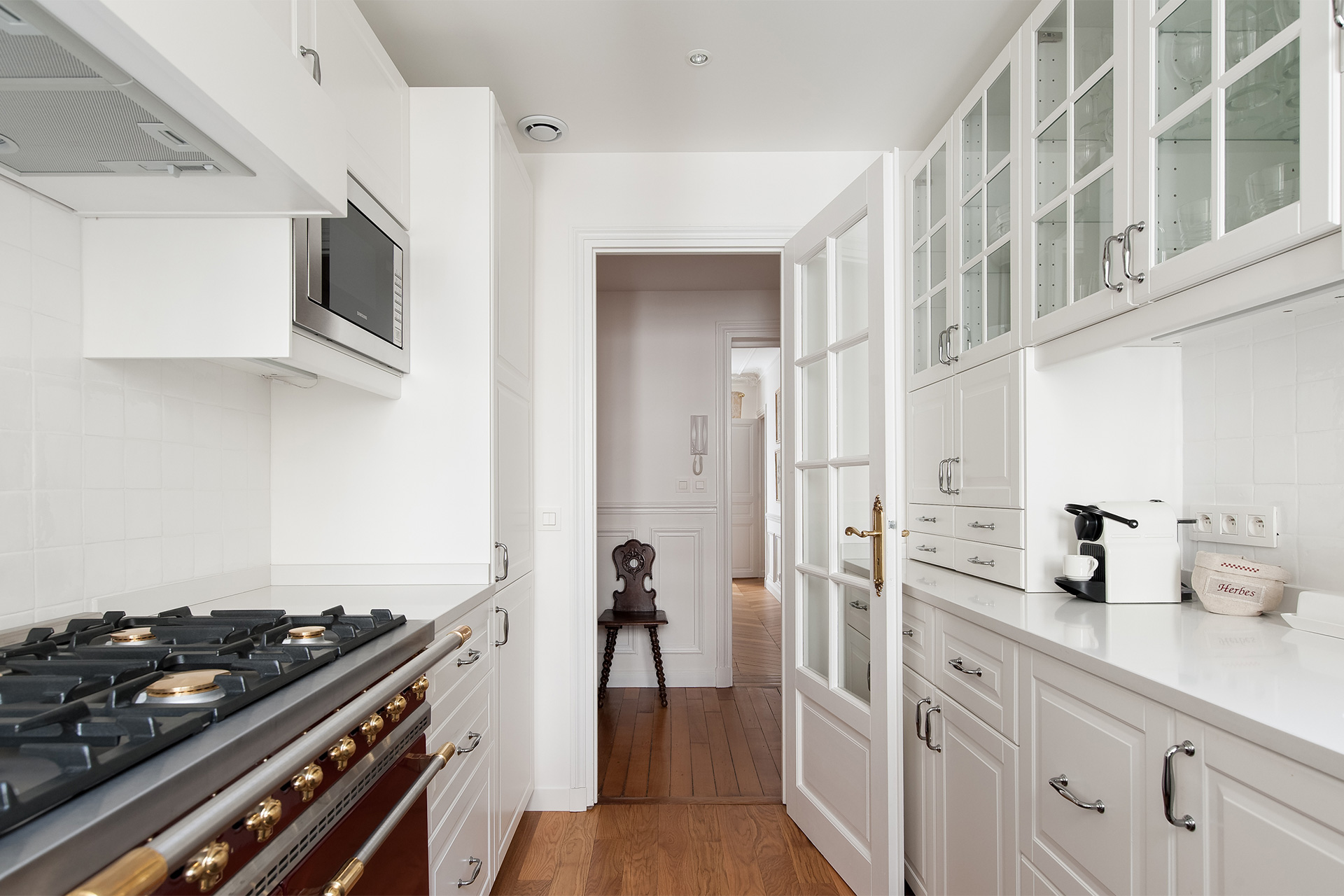 Kitchen is light-filled, crisp and beautiful in the Montagny vacation rental offered by Paris Perfect