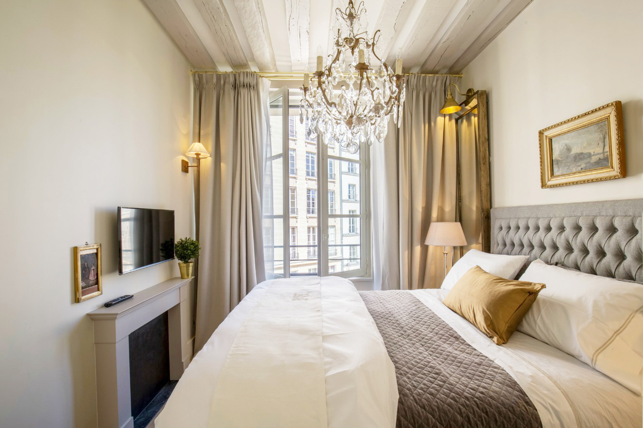 Watch TV from the comfort of your bed in the Castillon vacation rental offered by Paris Perfect