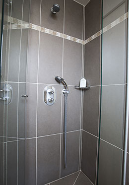 Shower with fixed and flexible showerheads in the Bergerac vacation rental offered by Paris Perfect