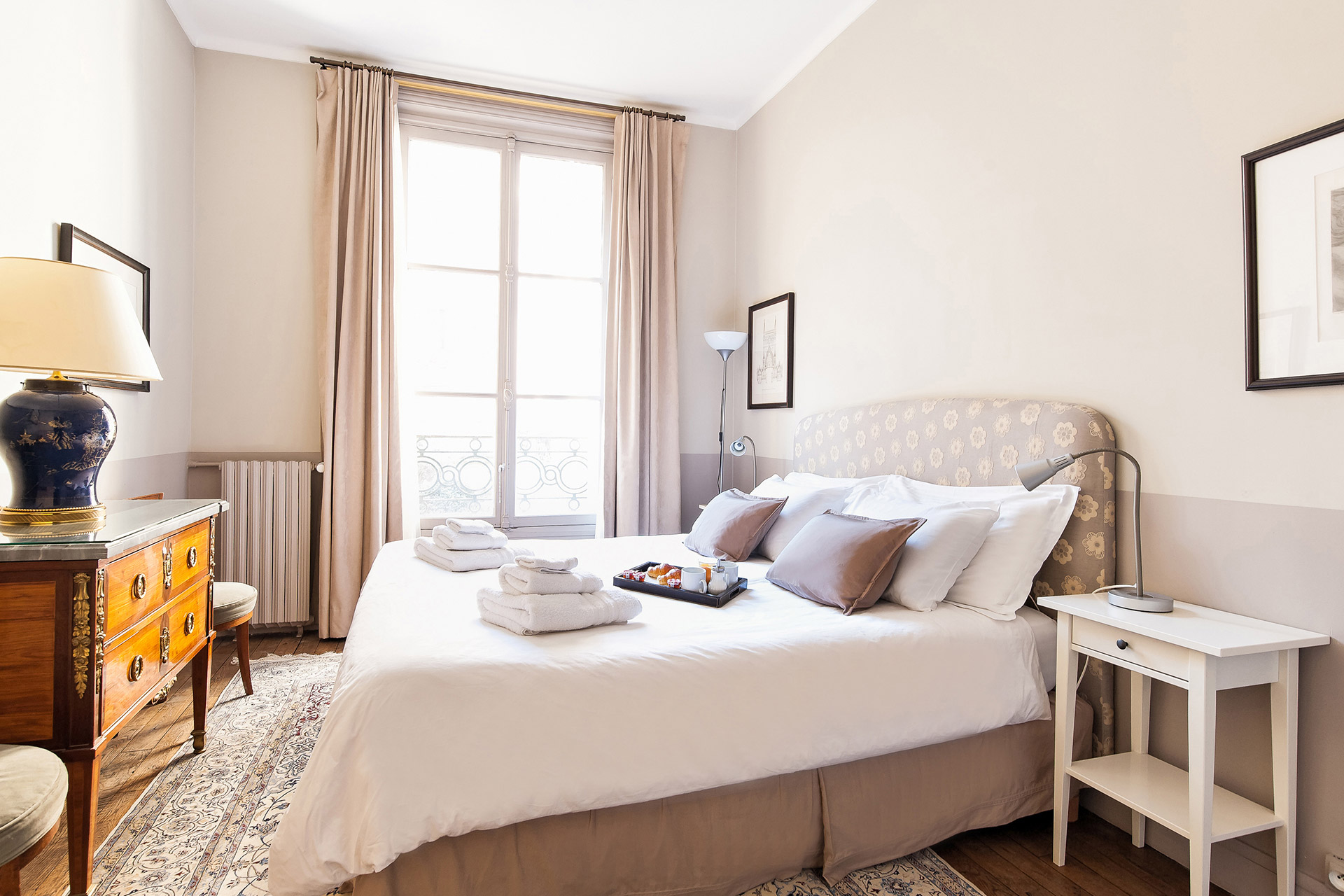 French windows and reading lamps in the Mâcon vacation rental offered by Paris Perfect