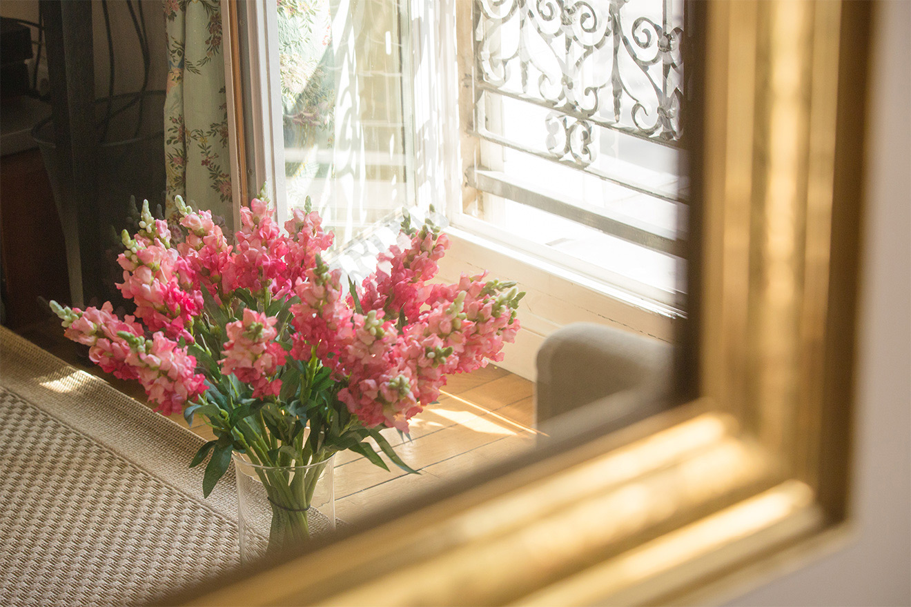 Fresh flowers from one of the local markets in the Saint Amour vacation rental offered by Paris Perfect