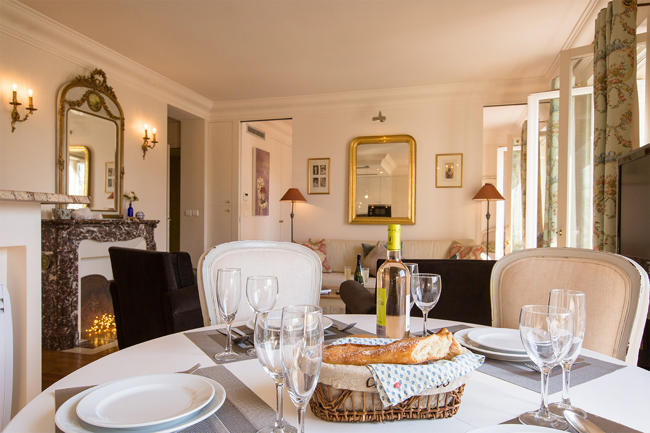 Dining table comfortably seats four in the Saint Amour vacation rental offered by Paris Perfect