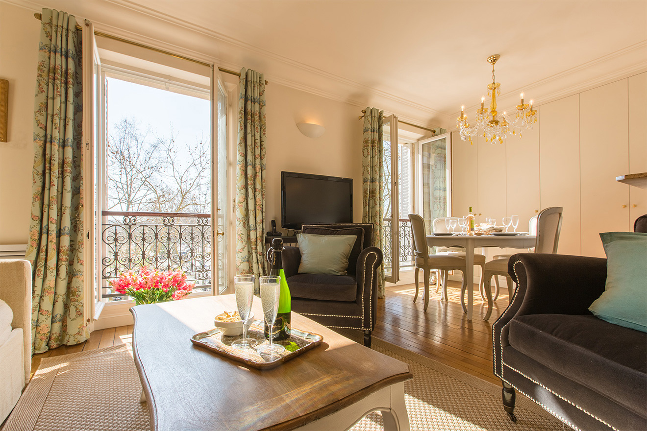 Large French windows in the Saint Amour vacation rental offered by Paris Perfect