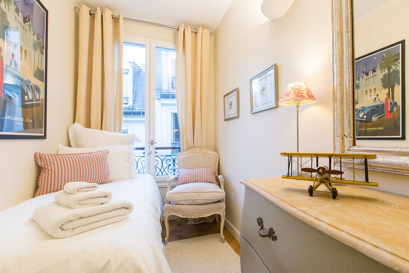 Cozy chair in the second bedroom of the Merlot vacation rental offered by Paris Perfect