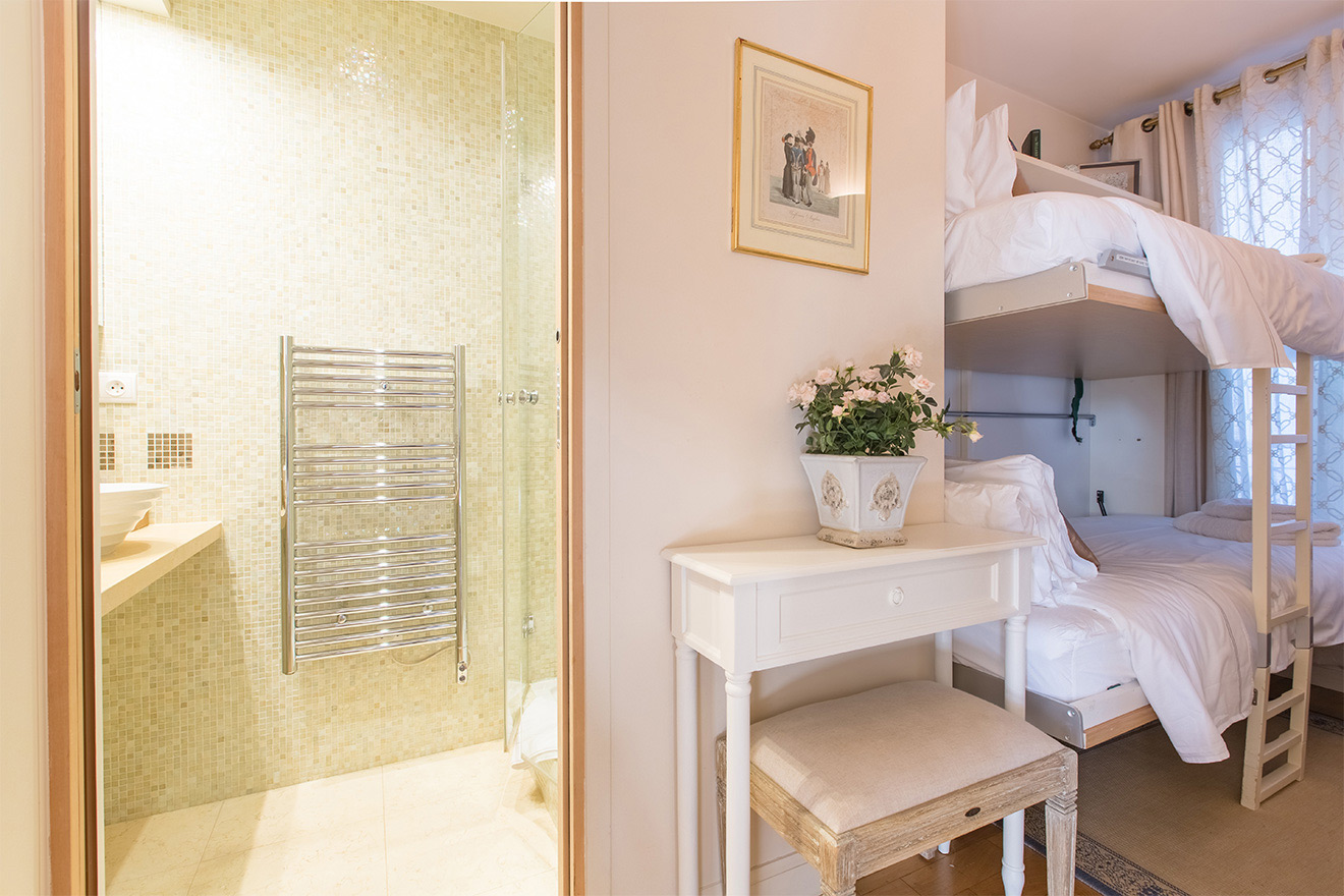 Second bedroom and bathroom in the Saint Amour vacation rental offered by Paris Perfect