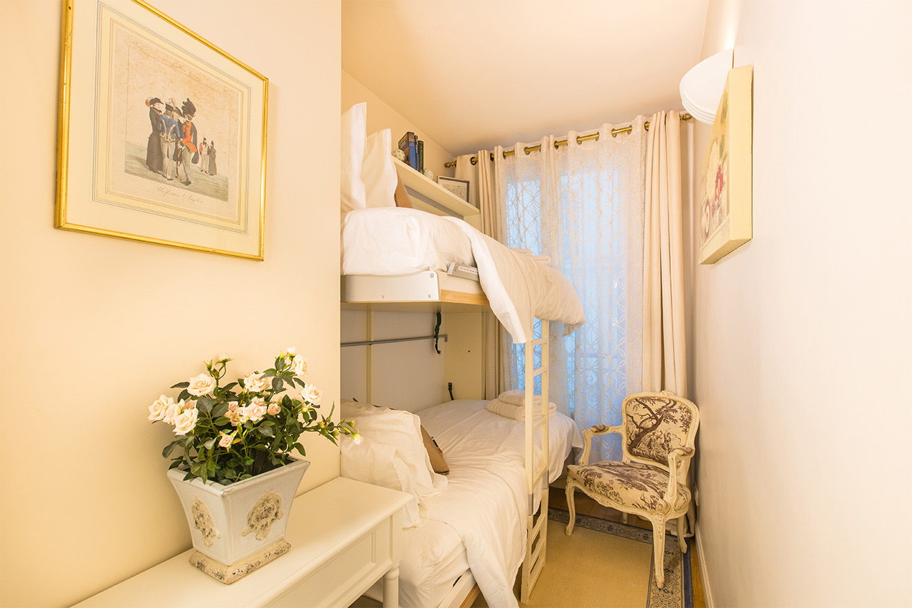 Bunk-beds rest in the second bedroom of the Saint Amour vacation rental offered by Paris Perfect