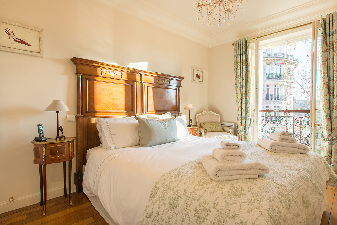 Paris sun in the beautiful first bedroom of the Saint Amour vacation rental offered by Paris Perfect
