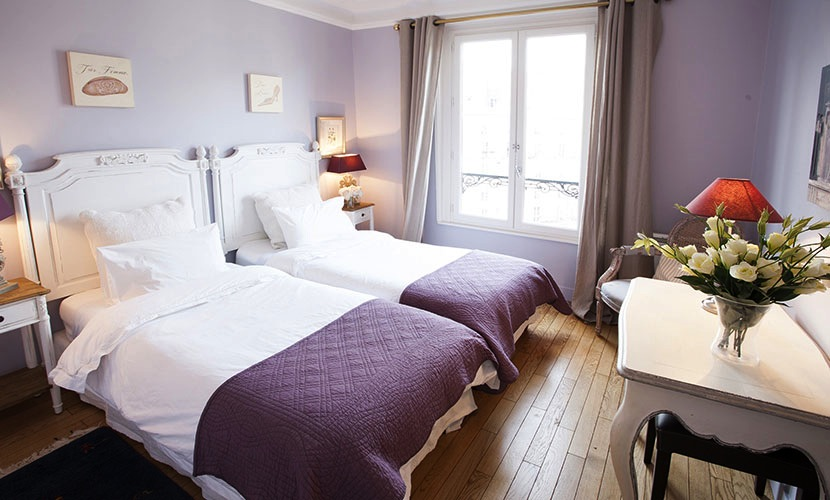 Bedroom Two has twin beds and Eiffel Tower views