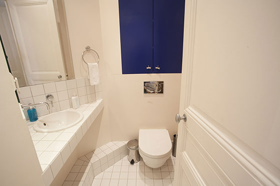 Powder room with toilet and sink in the Chateauneuf vacation rental offered by Paris Perfect