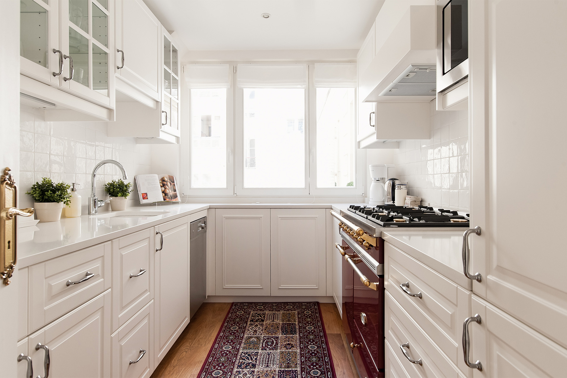 Kitchen cabinets in the Montagny vacation rental offered by Paris Perfect
