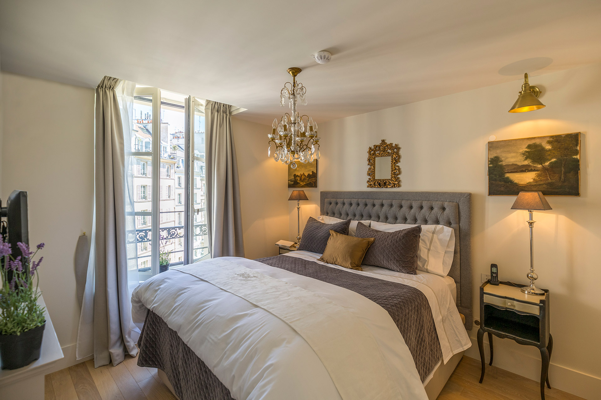 The bedroom is spacious and beautifully decorated in the Loupiac vacation rental offered by Paris Perfect