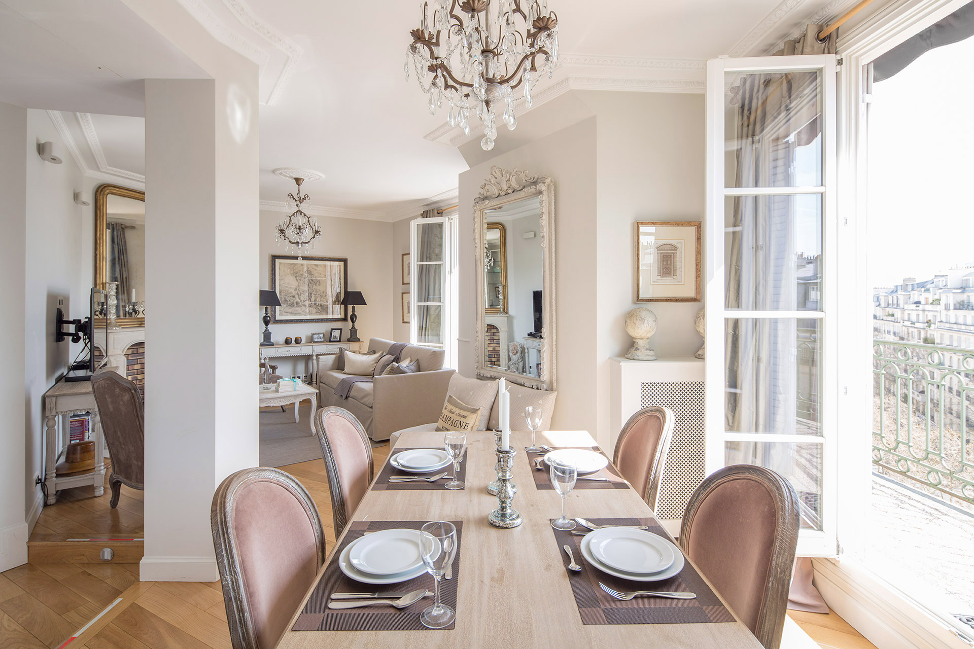 Dining table near the French doors seat up to six in the Margaux vacation rental offered by Paris Perfect