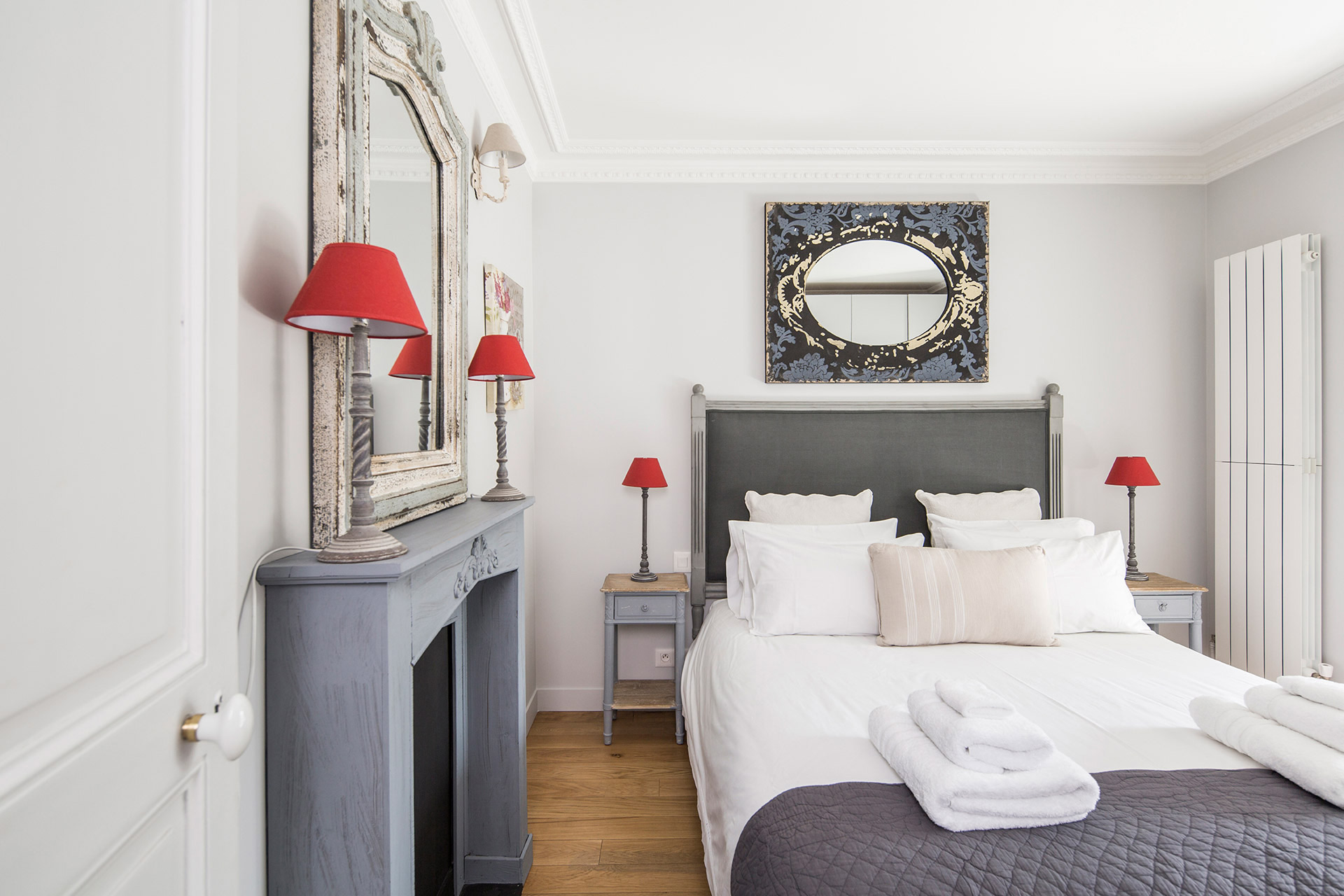 Bright and airy bedroom of the Chambertin vacation rental offered by Paris Perfect