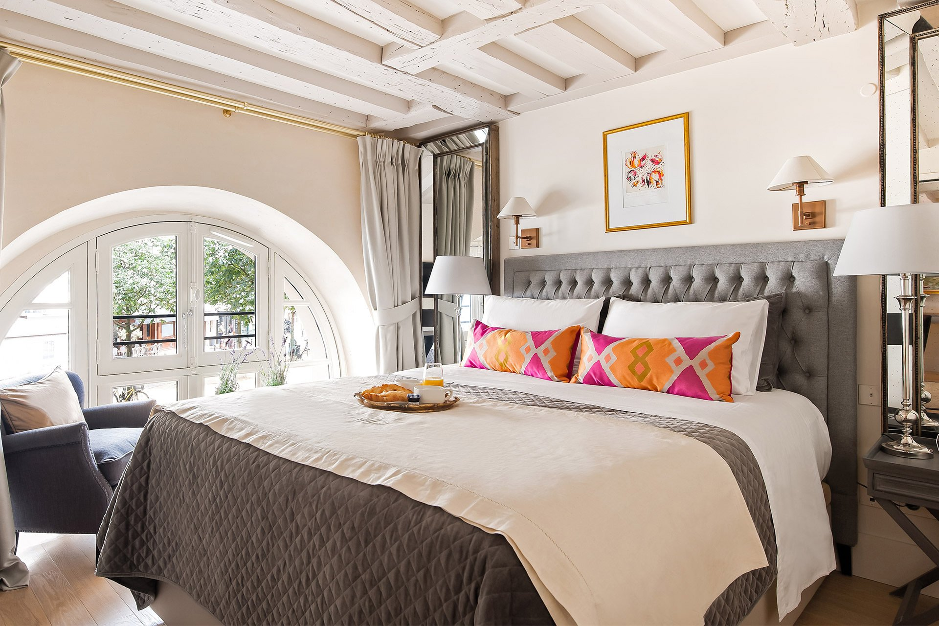 Bedroom with extra wide queen bed in the Anjou vacation rental offered by Paris Perfect