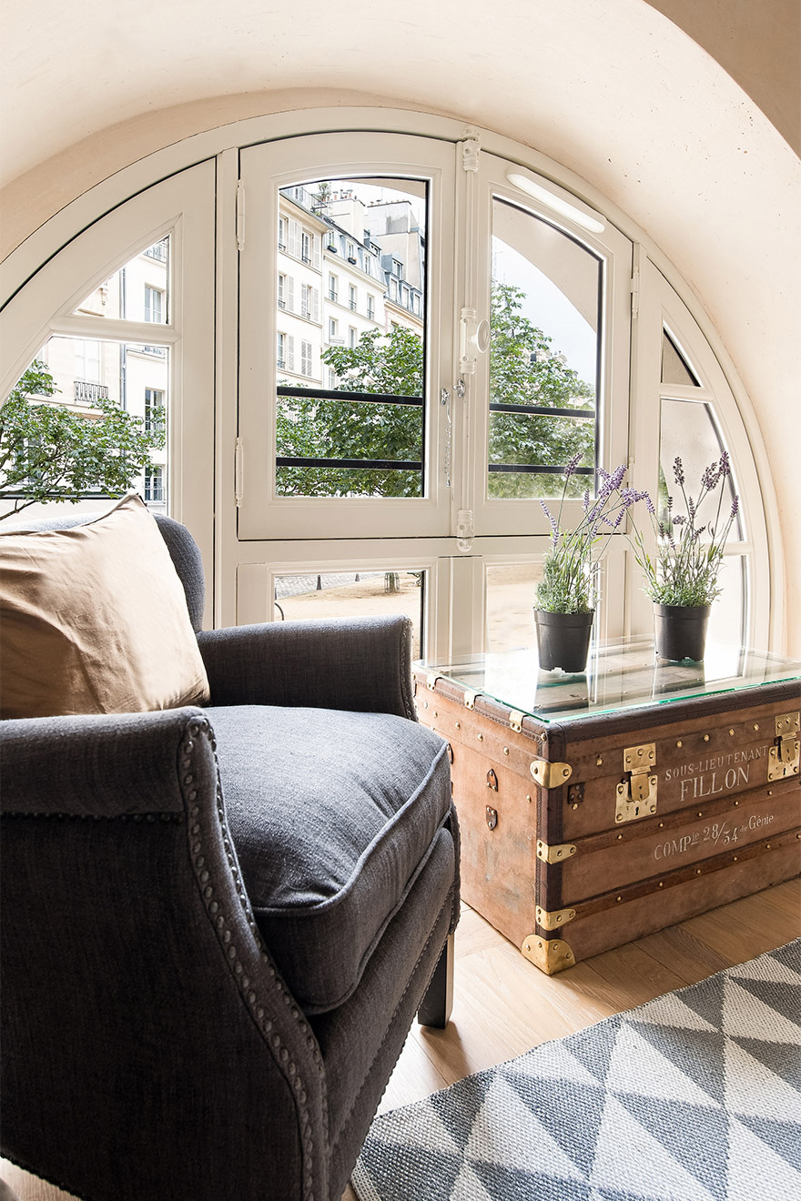 Bedroom window overlooks Place Dauphine in the Anjou vacation rental offered by Paris Perfect