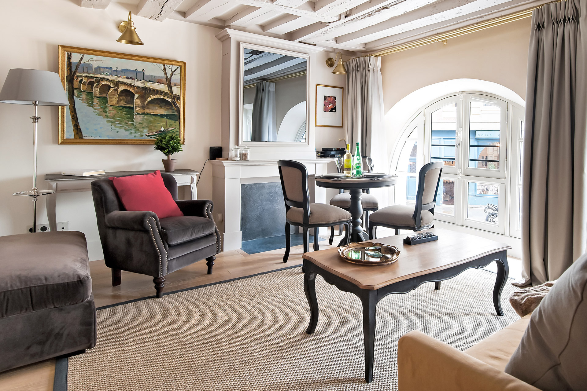 Ceiling beams give this place a historic essence in the Anjou vacation rental offered by Paris Perfect