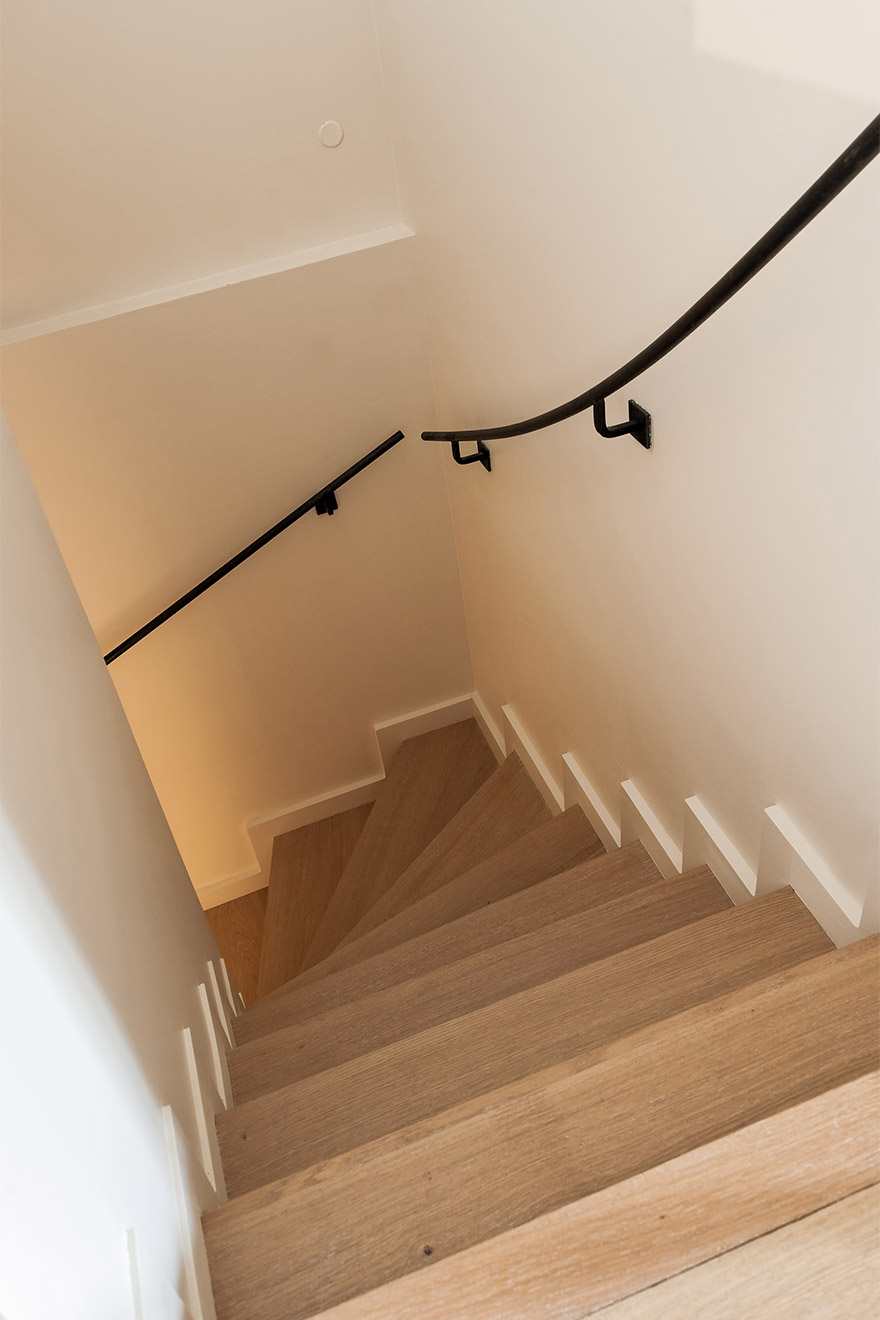 Staircase leads to the apartment's ground floor in the Anjou vacation rental offered by Paris Perfect