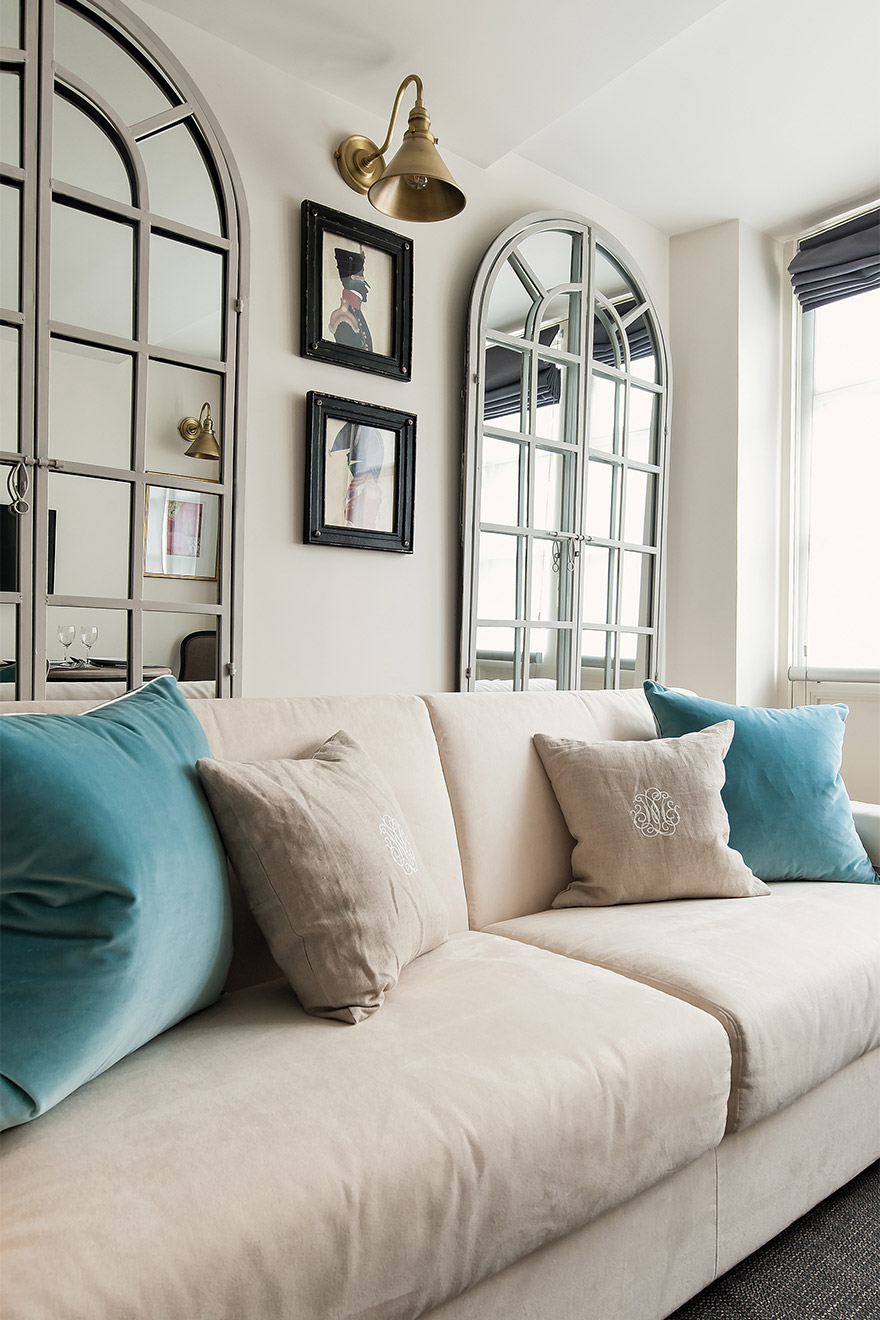 The perfect couch for lounging in the Anjou vacation rental offered by Paris Perfect
