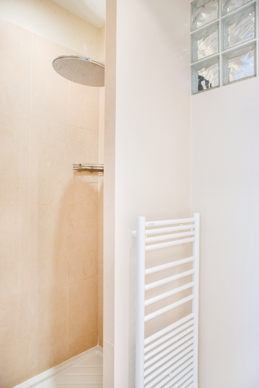 Walk-in rain shower in the Corent apartment by Paris Perfect