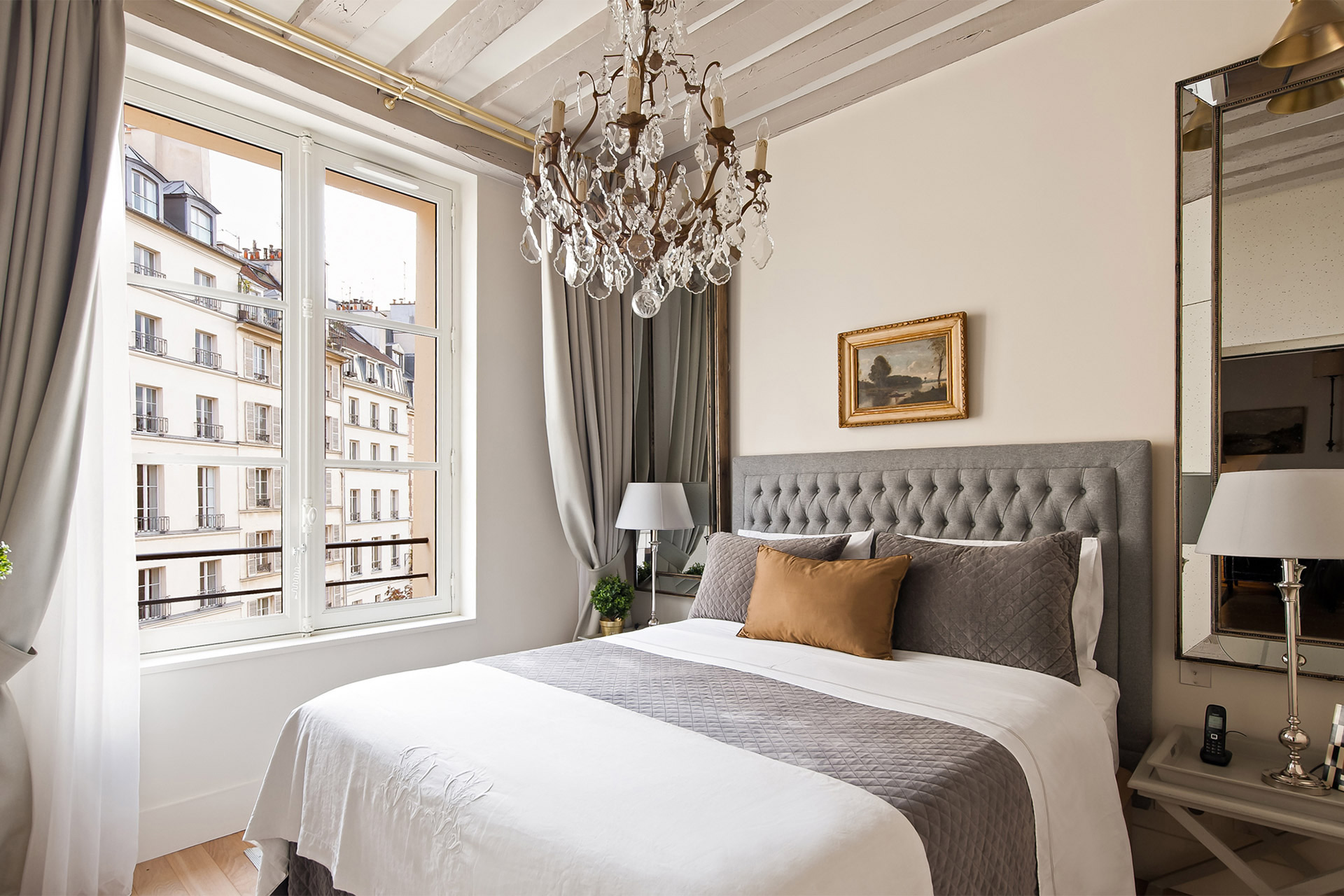 Step into this elegant bedroom in the Castillon vacation rental offered by Paris Perfect