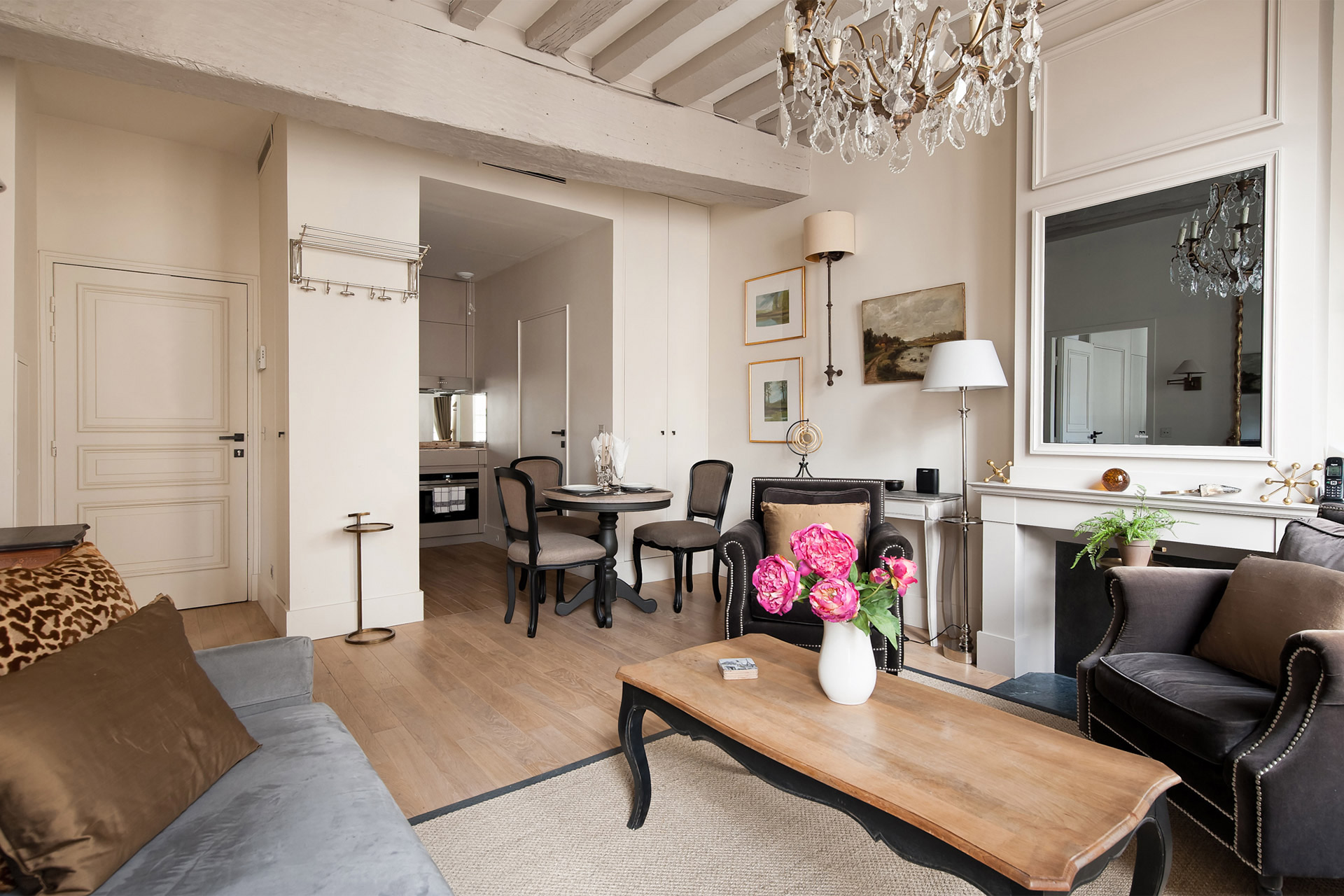 View towards the dining area and kitchen of the Castillon vacation rental offered by Paris Perfect