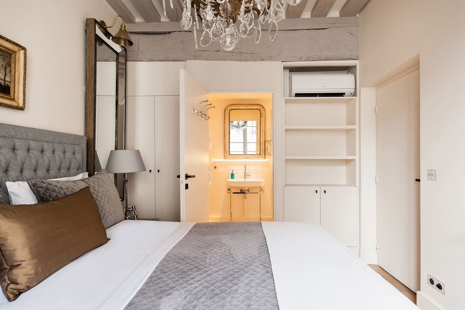 En suite bathroom and ample storage in the bedroom of the Castillon vacation rental offered by Paris Perfect