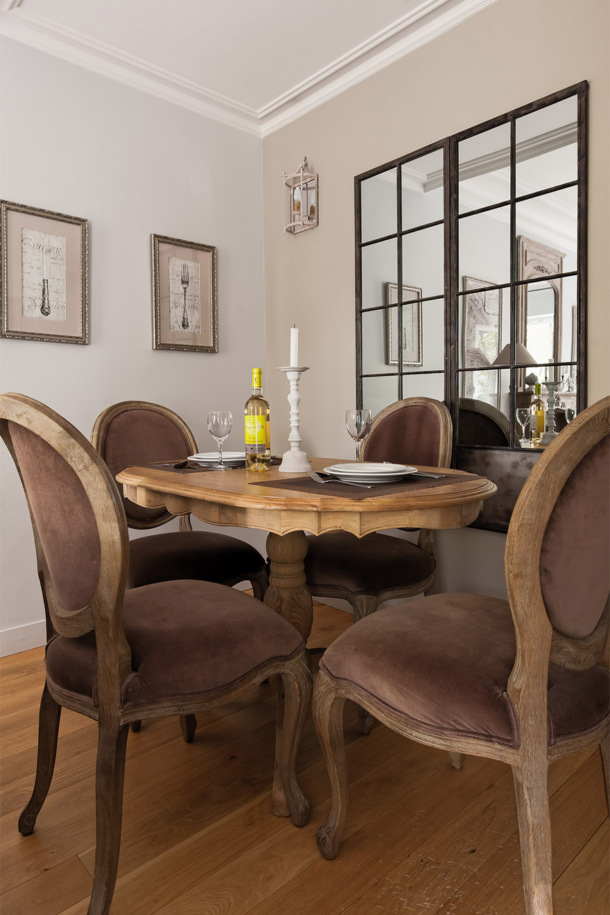 Dining table in the Chambertin vacation rental offered by Paris Perfect