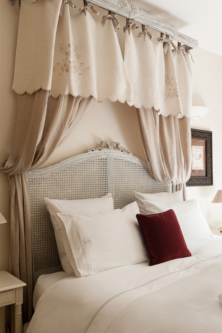 Beautiful details above the bed of the Champagne vacation rental offered by Paris Perfect