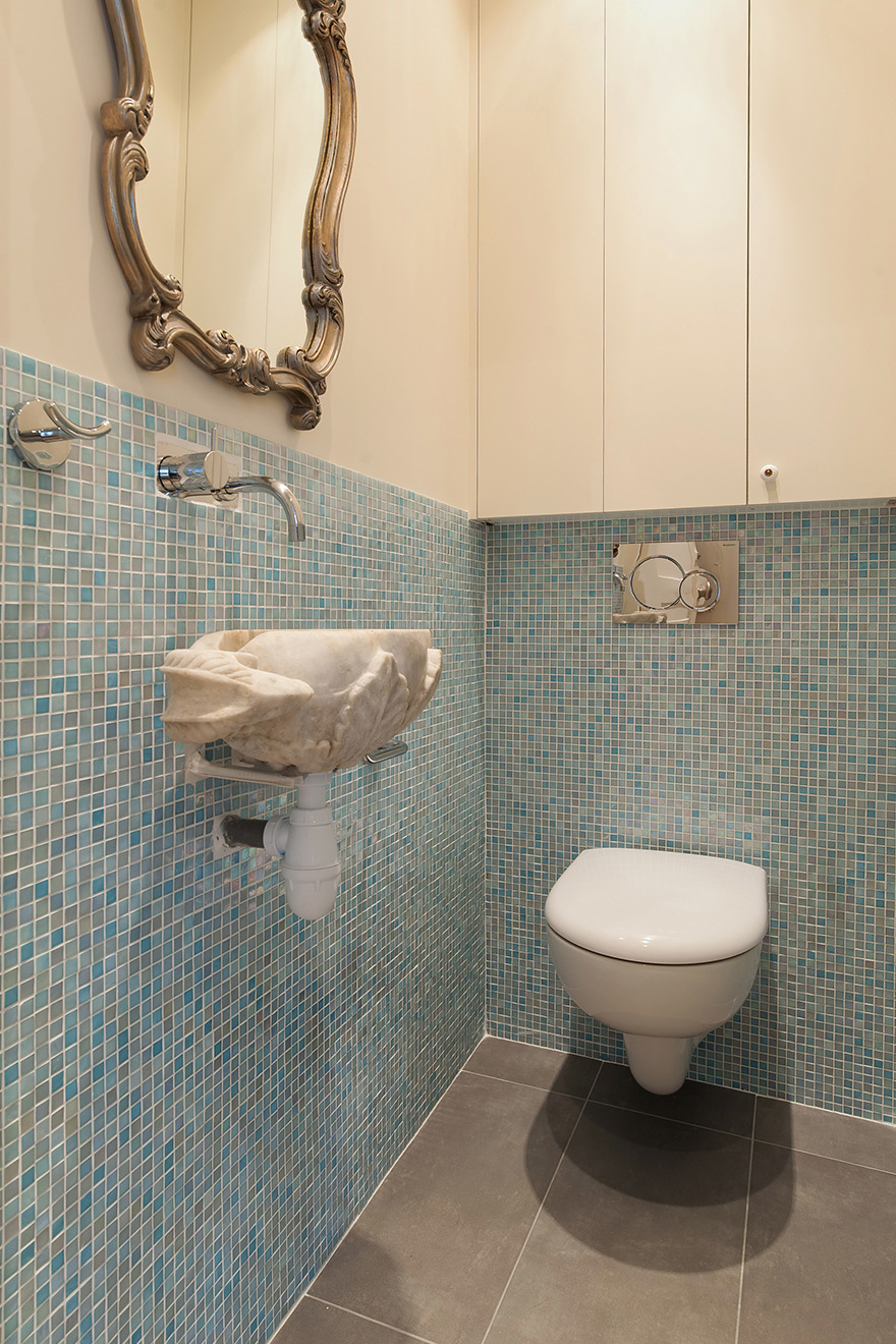half bath with aqua blue tiles