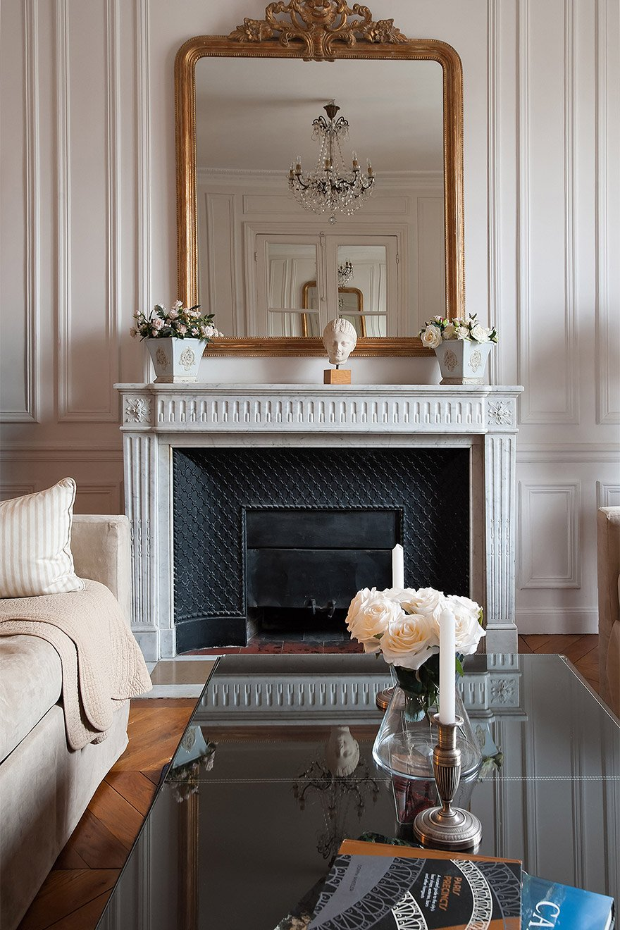 Marble fireplace in the Chateauneuf vacation rental offered by Paris Perfect