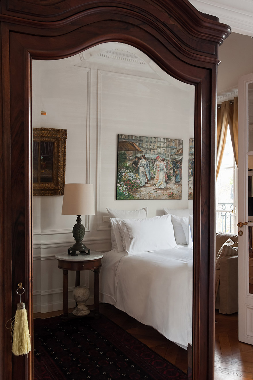Large antique armoire for extra storage in the Chateauneuf vacation rental offered by Paris Perfect