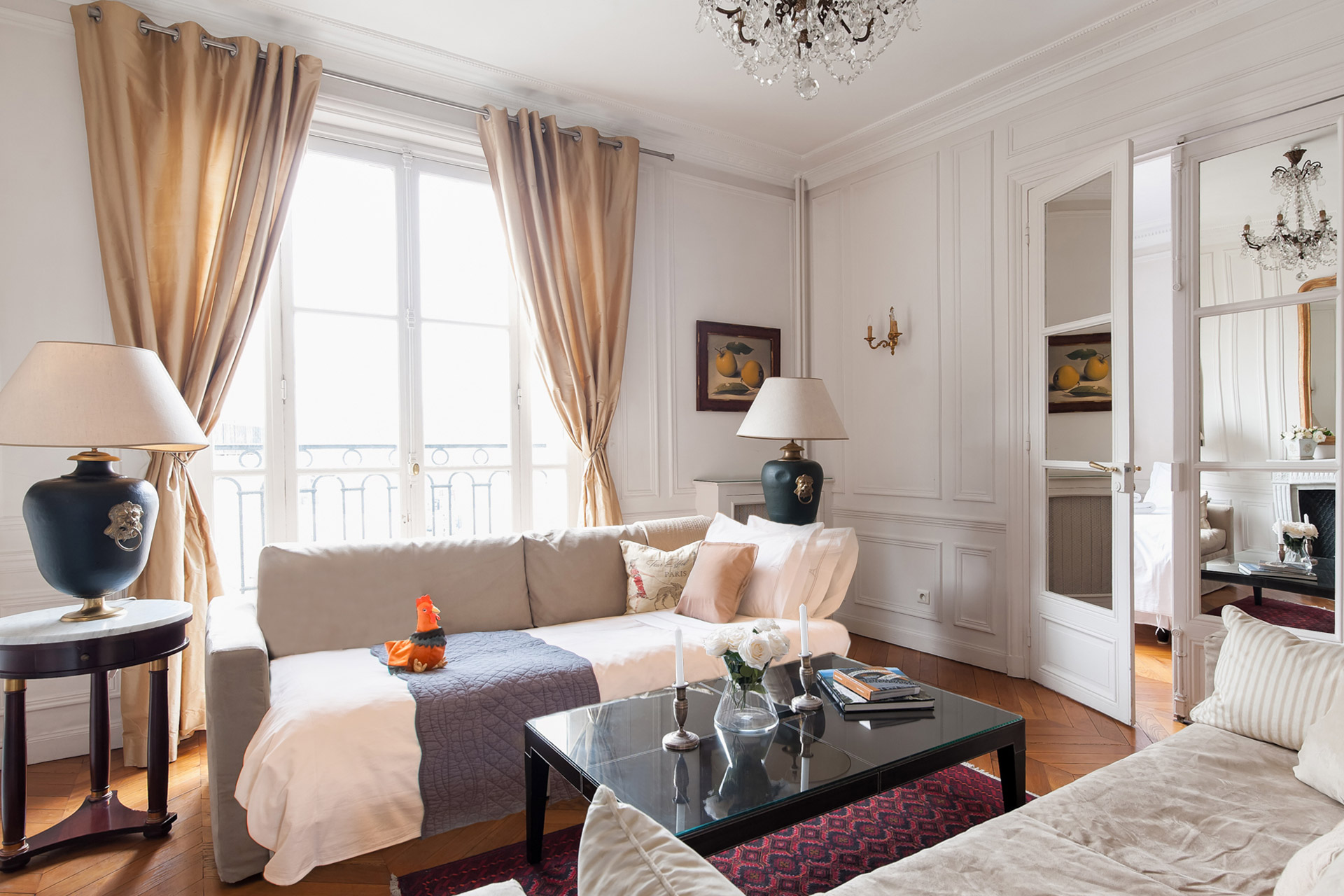 Living room with dual sofa beds in the Chateauneuf vacation rental offered by Paris Perfect