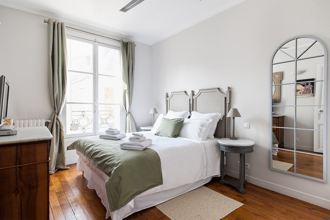 Light and sunny first bedroom of the Cognac vacation rental offered by Paris Perfect