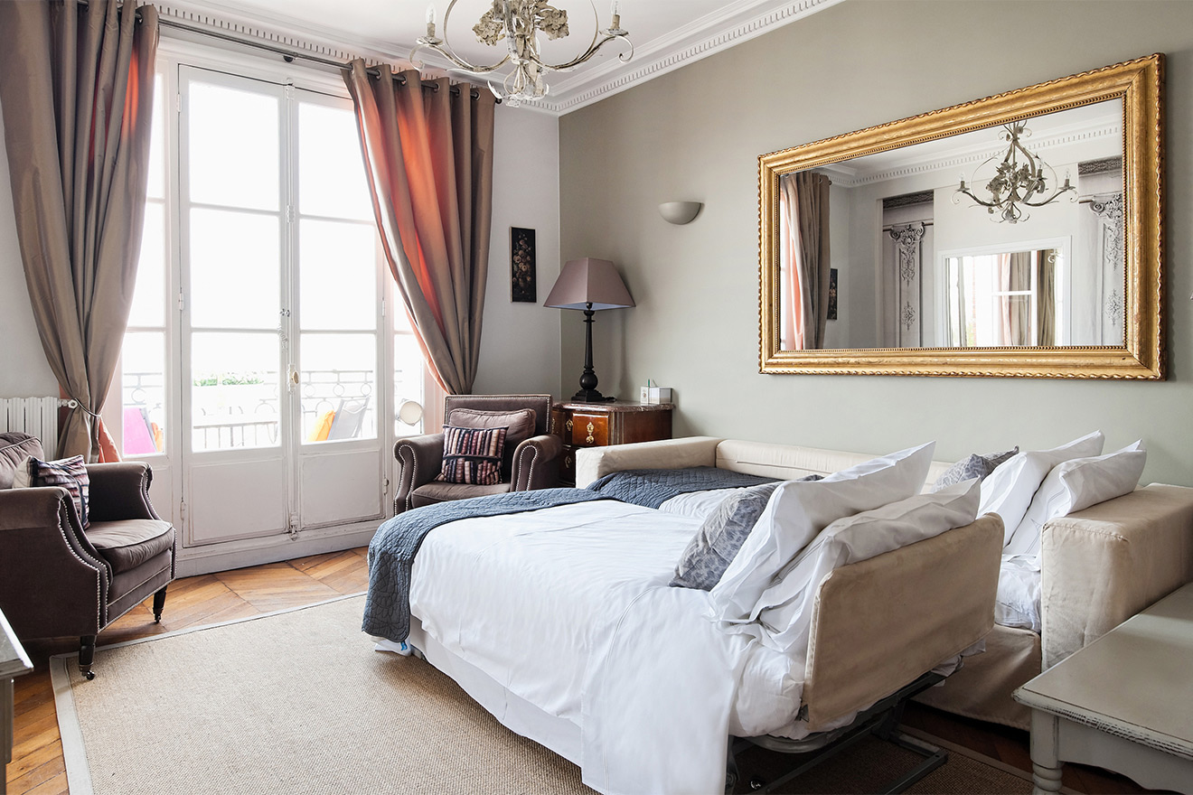 Wake up to an incredible Eiffel Tower view in the Cognac vacation rental offered by Paris Perfect