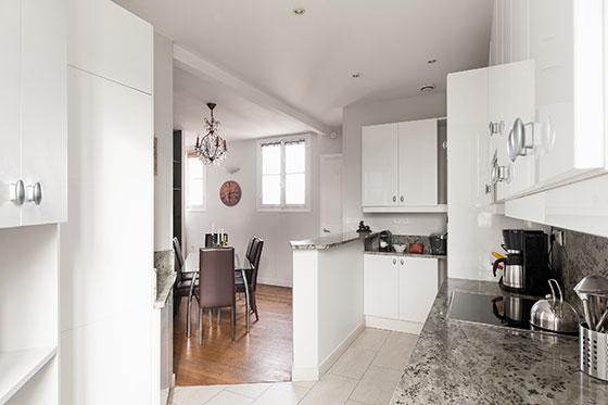 Beautifully designed open plan kitchen of the Cognac vacation rental offered by Paris Perfect