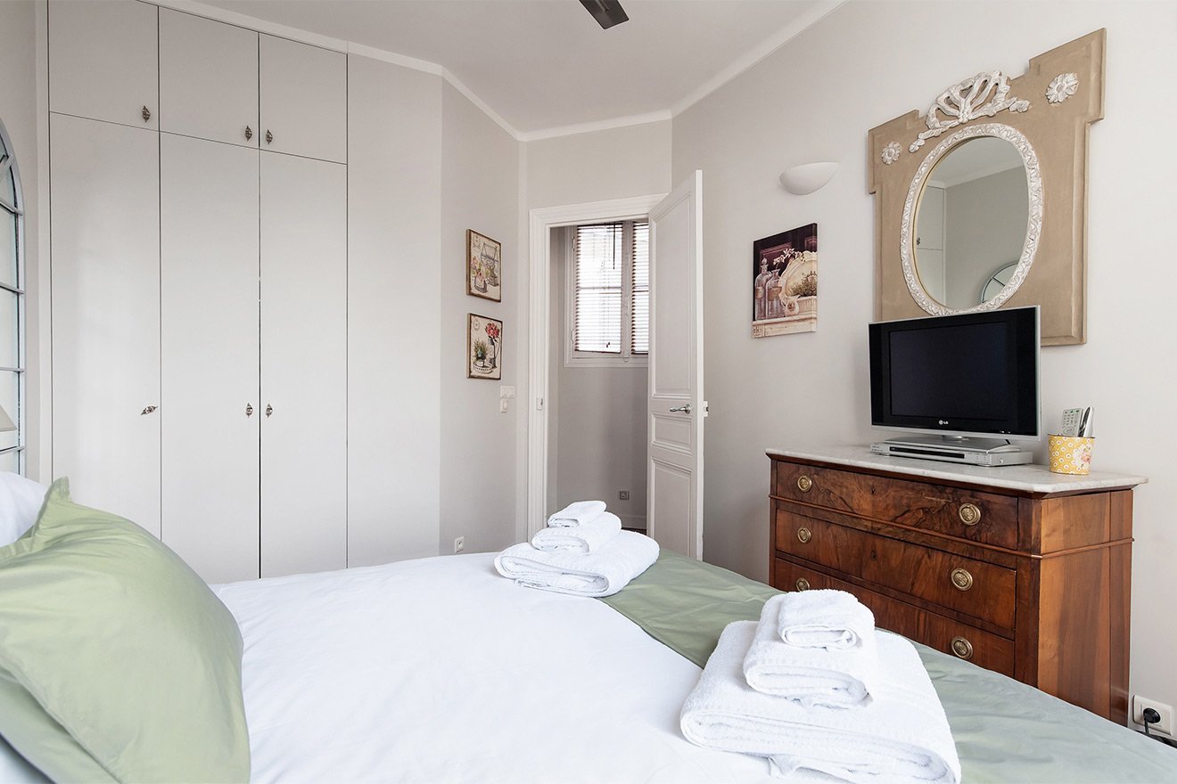 Built-in closests in the bedroom for storage in the Cognac vacation rental offered by Paris Perfect