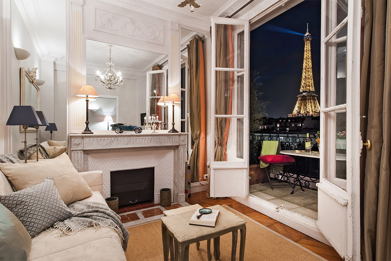 View of the Eiffel Tower at night from the living room of the Cognac vacation rental