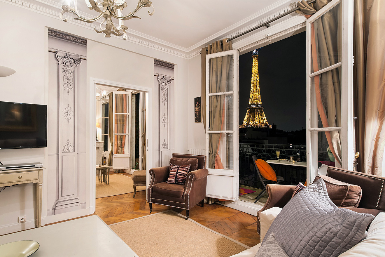 Watch the Eiffel Tower sparkle from your living room of the Cognac vacation rental offered by Paris Perfect