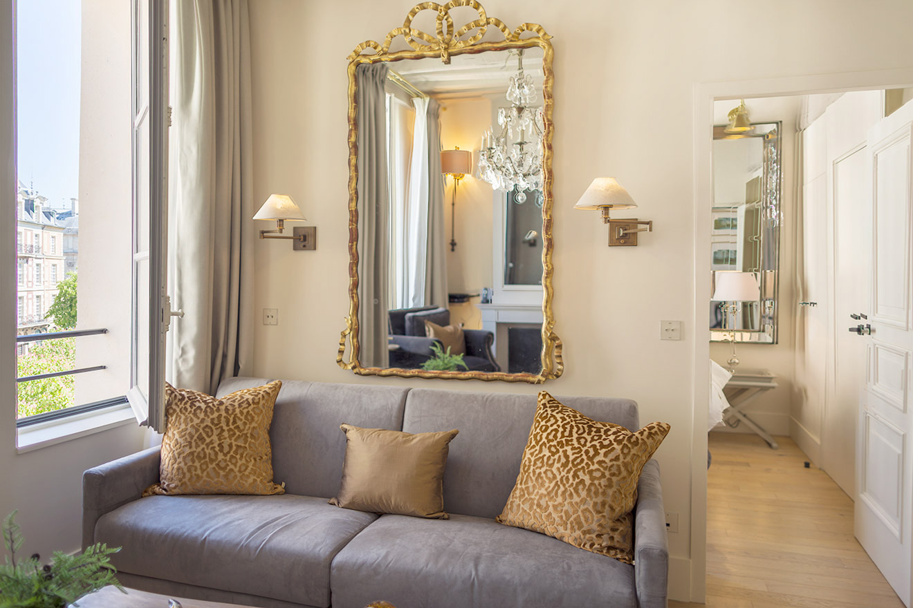 Elegant sofa with view over Place Dauphine in the Castillon vacation rental offered by Paris Perfect