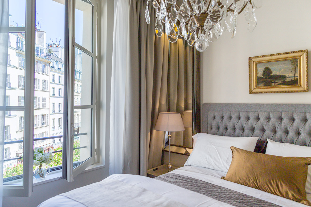 Pretty views of Place Dauphine from the bedroom window of the Castillon vacation rental offered by Paris Perfect