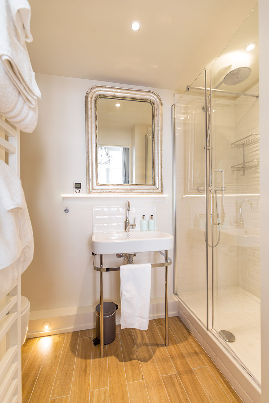 Large shower with rainfall shower head in the Castillon vacation rental offered by Paris Perfect