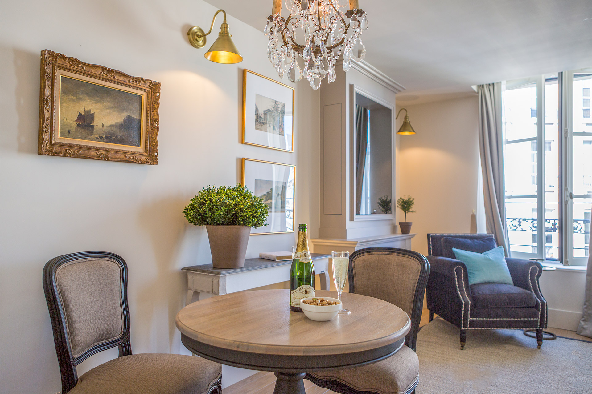 Dining table comfortably seats two guests in the Loupiac vacation rental offered by Paris Perfect