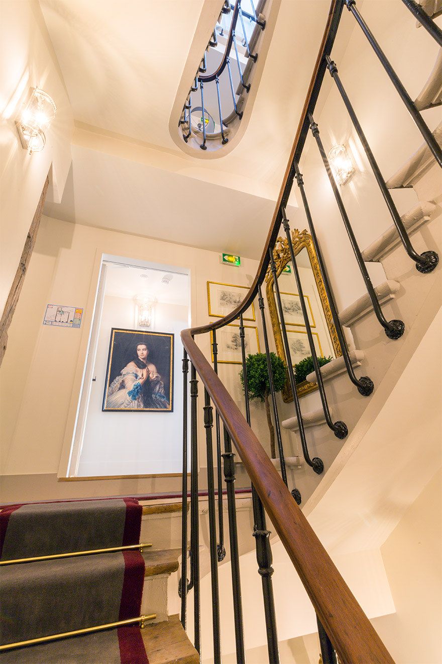 Take the stairs or elevator to the Loupiac vacation rental offered by Paris Perfect