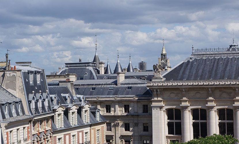 View of Paris rooftops from the Savennières vacation rental offered by Paris Perfect