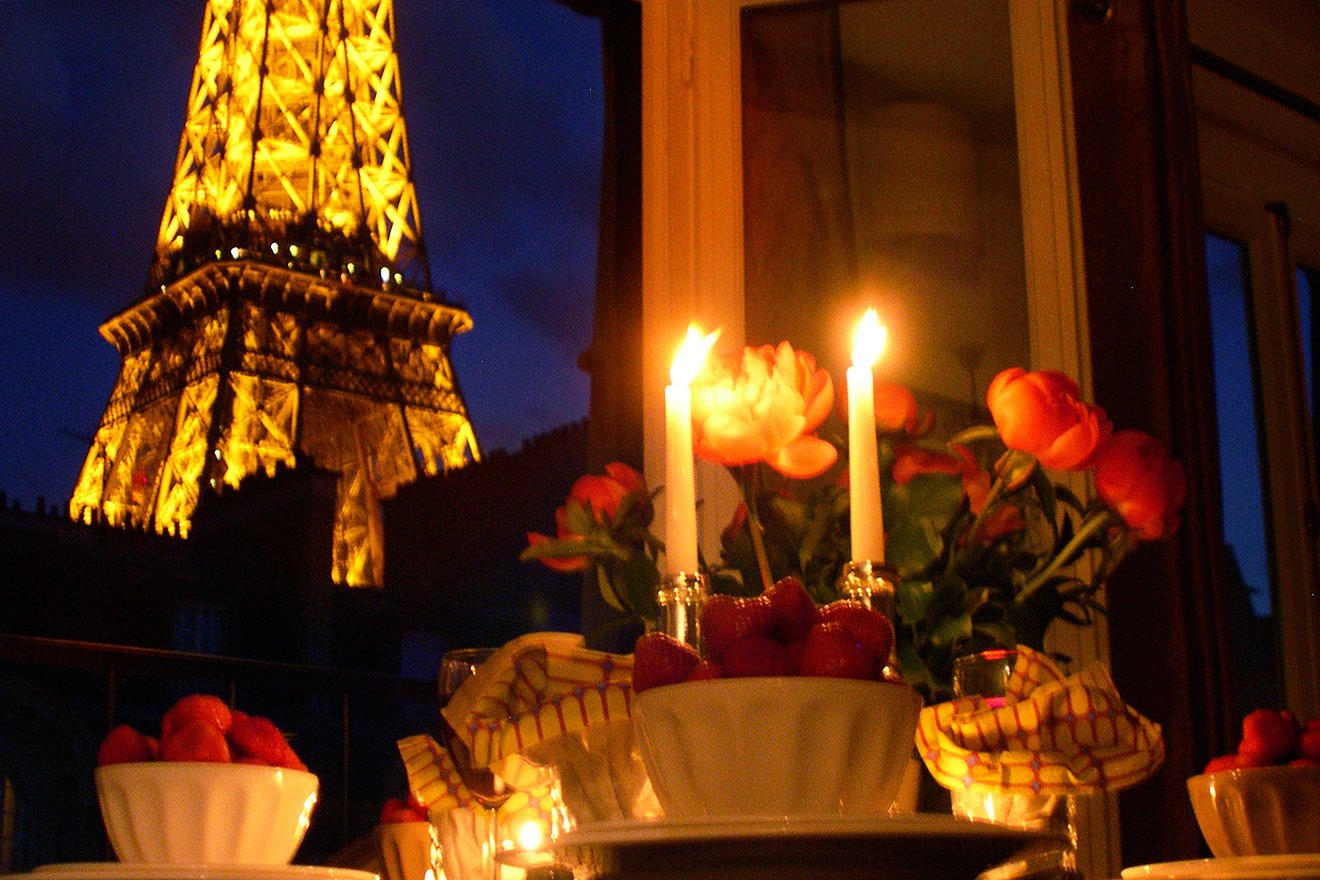 Candle-lit dinner with awesome Eiffel Tower views in the Chablis vacation rental offered by Paris Perfect