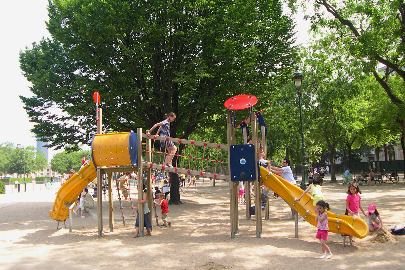 Enjoy the gardens and playgrounds at the Champ de Mars park