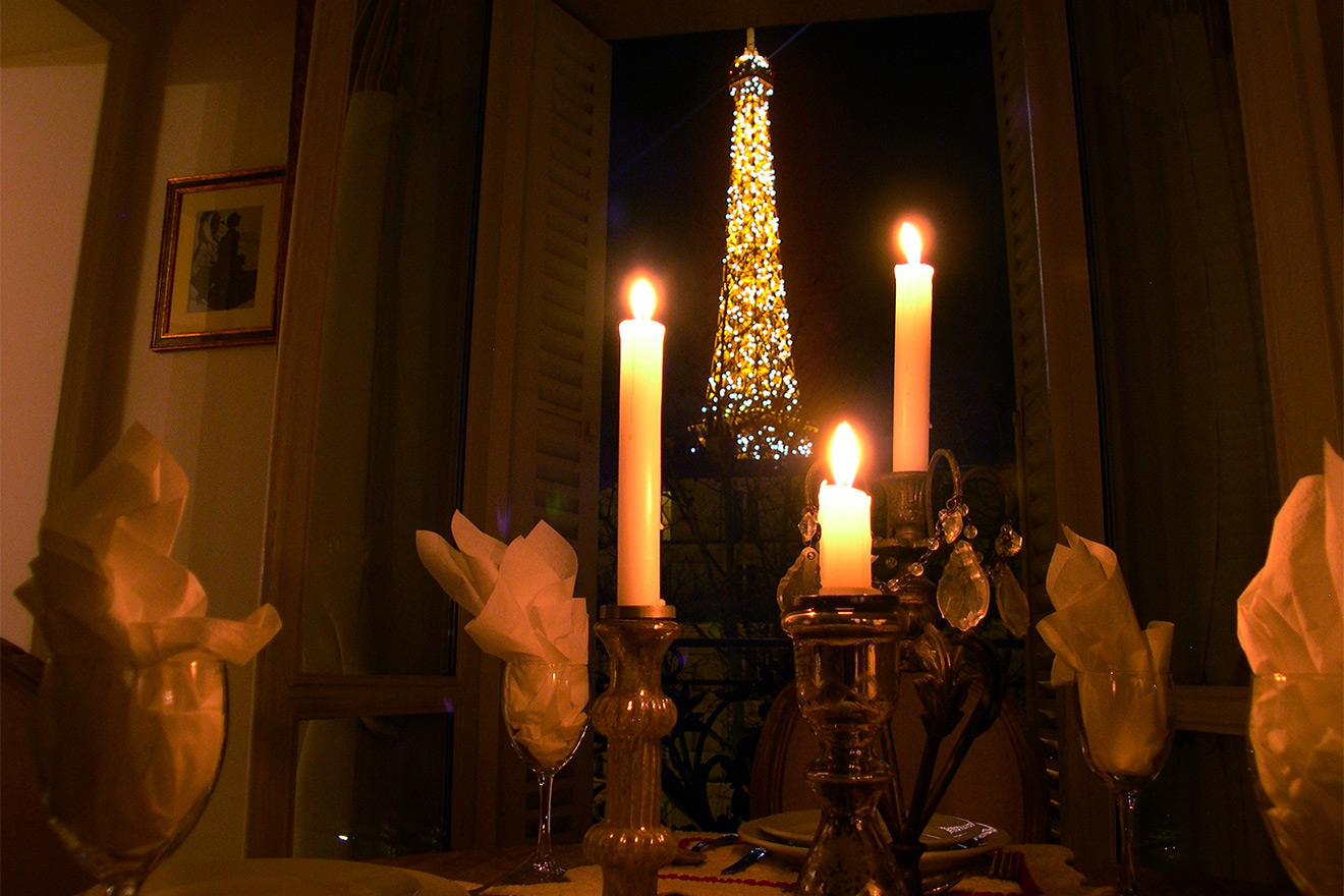 Enjoy a candlelit dinner with stunning Eiffel Tower views