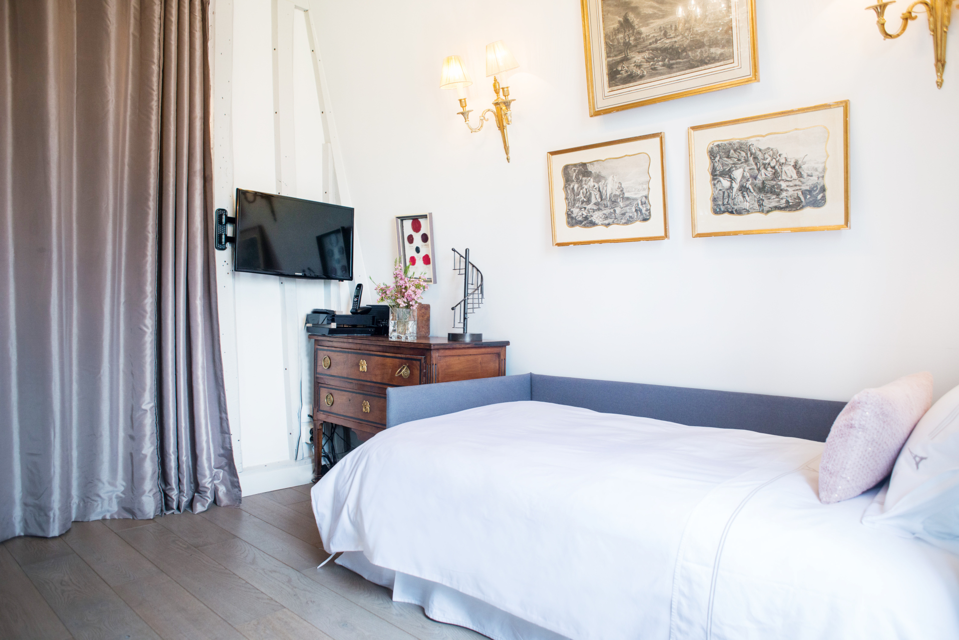 Close off the living room with these beautiful curtains in the Cremant vacation rental by Paris Perfect