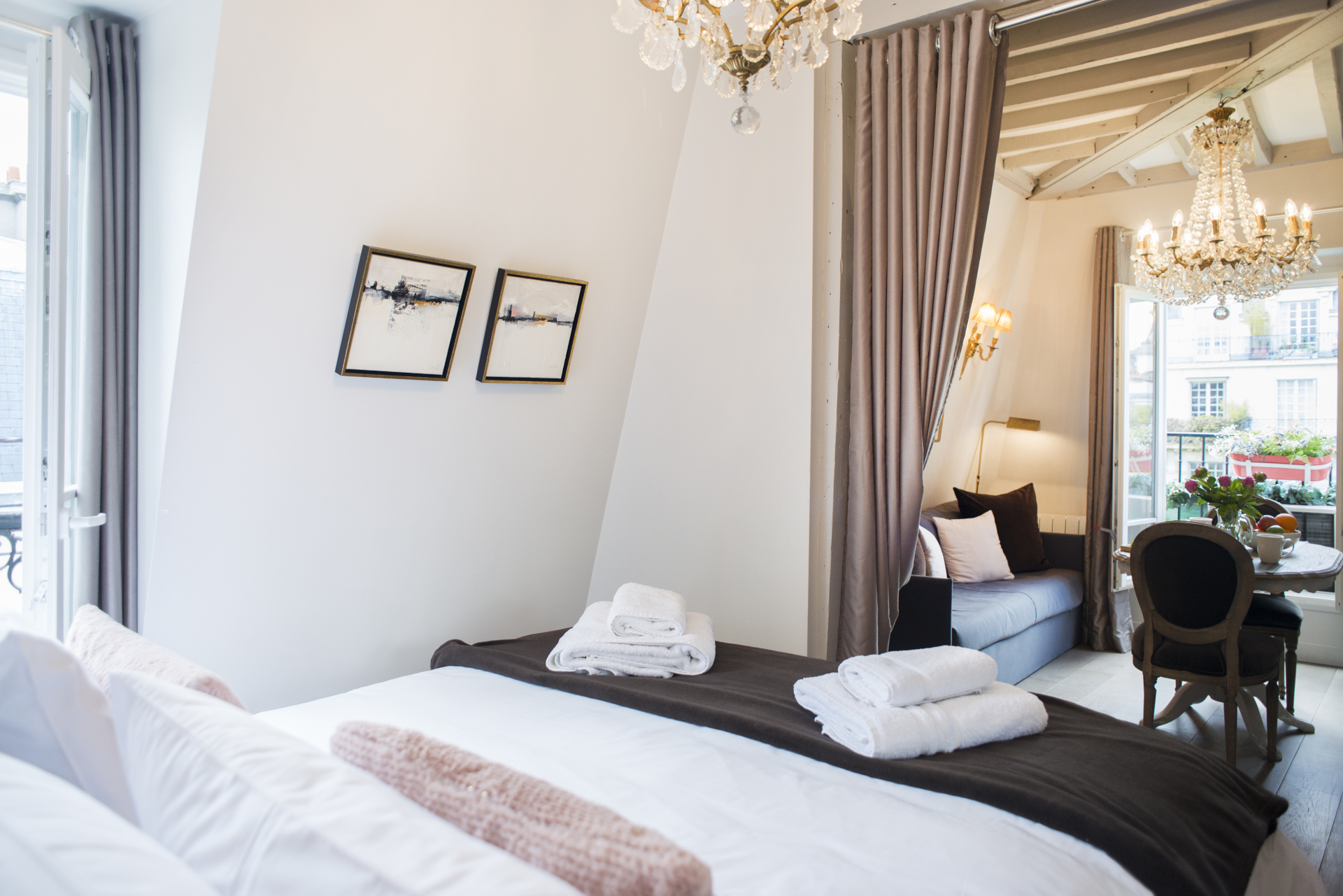 Bedroom area can be separated by rich curtains in the Cremant vacation rental by Paris Perfect