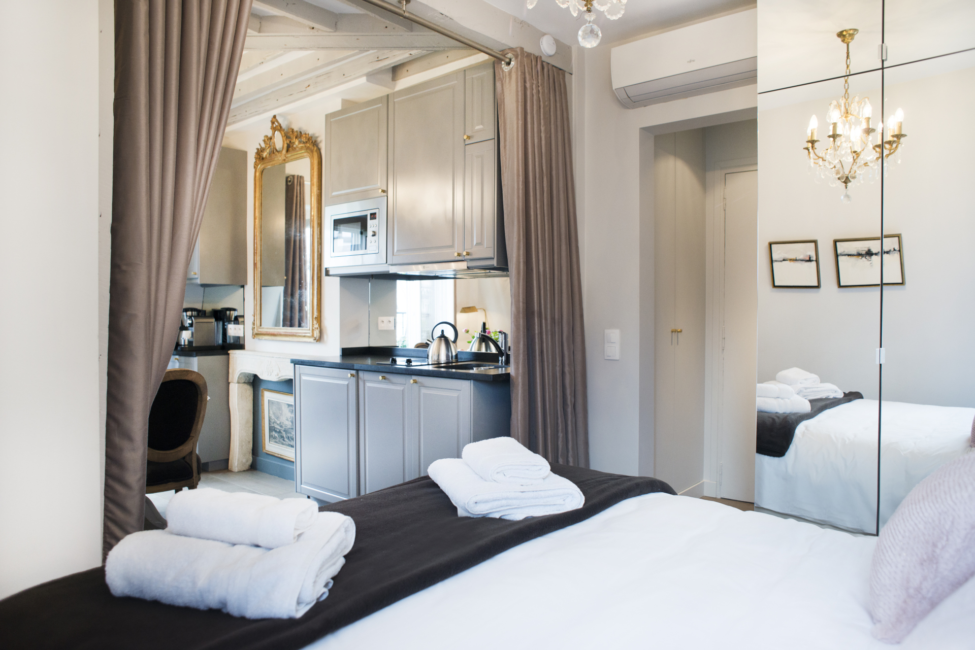 Sleeping area can be closed off by large curtains in the Cremant vacation rental